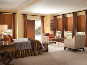 The bedroom with matching sliding panels and cordless cellular shades