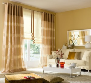 Flat fold roman shades accompained of beautiful grommet panels