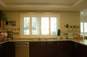 White bifold wood shutters