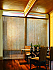 Vertical Natural Weaves blinds in a dining room